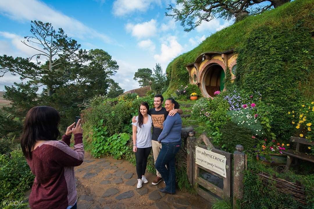 Guests posing for a photo at The Hobbiton Movie Set